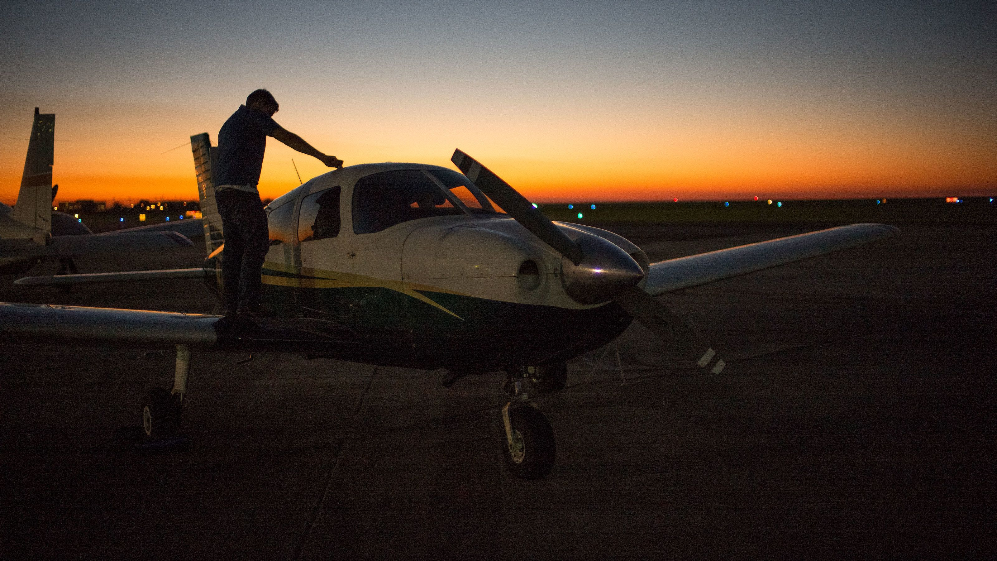 man washing small plane in New Orleans