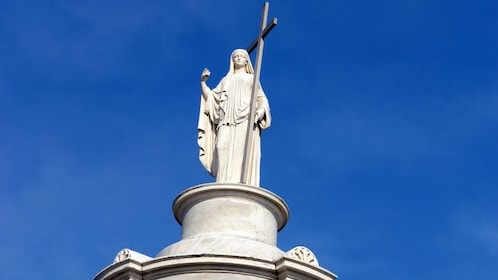 statue of woman in cemetary in New Orleans