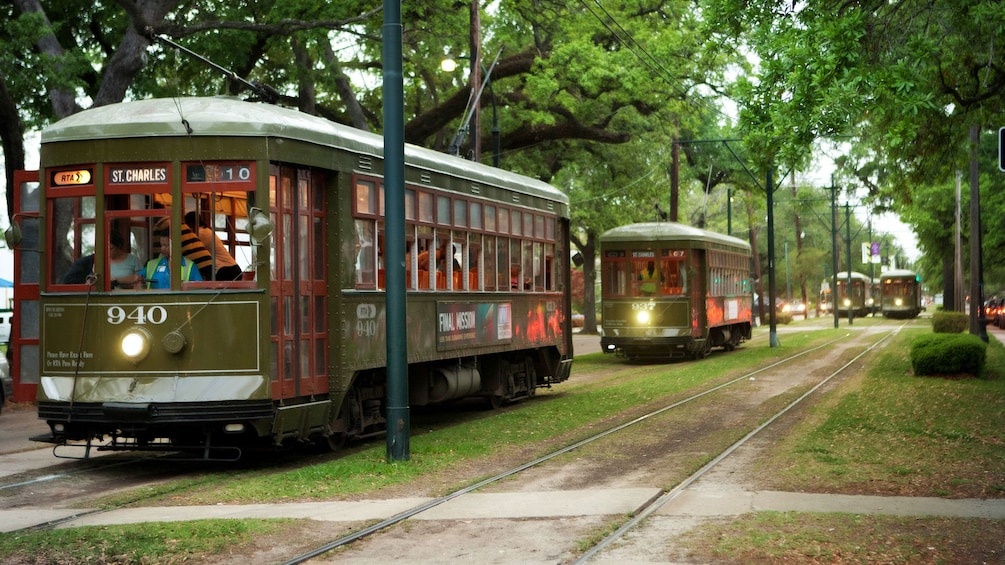 Show item 3 of 9. trolley cars on city streets in New Orleans