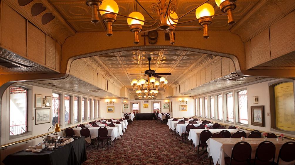 Cargar ítem 3 de 10. passenger dining area aboard steamboat in New Orleans