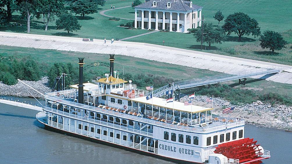 Cargar ítem 1 de 8. ariel view of paddle boat on river in New Orleans
