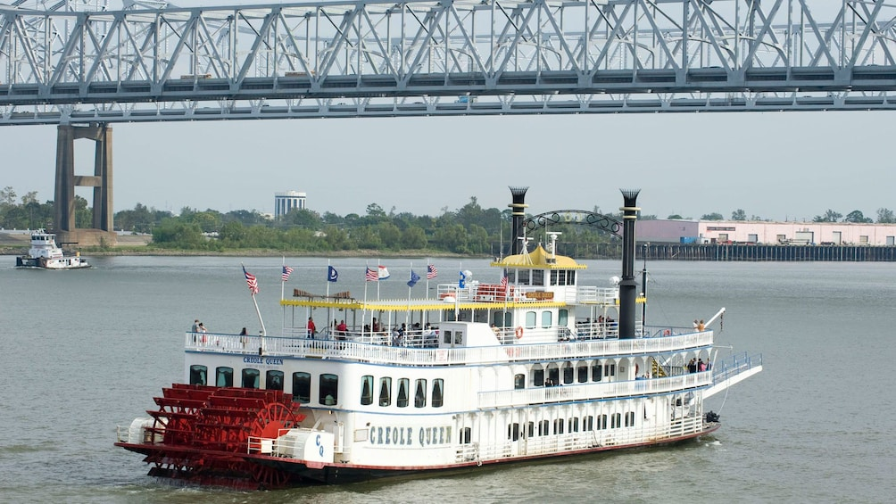 Paddleboat traveling down river in New Orleans