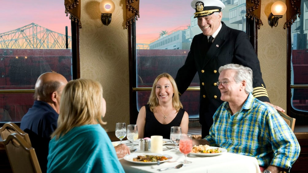 Show item 9 of 9. river boat talking to guest at dinner in New Orleans