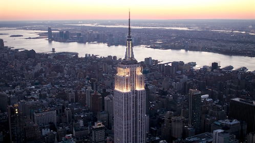 Empire State Building lit up at dusk in New York