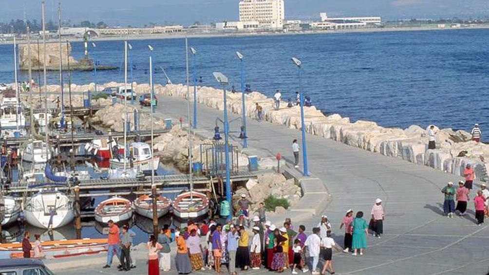 People walking along the waterfront in Acre