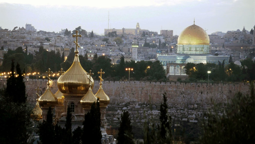 Show item 4 of 6. View of Jerusalem and the temple of the Dome of the Rock in the distance