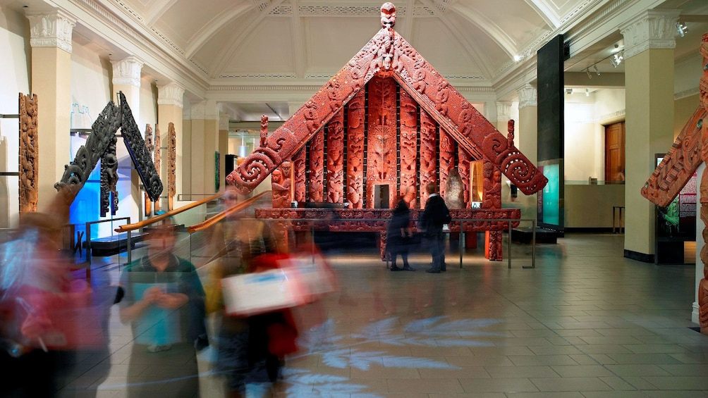 Show item 2 of 7. Full-size intricately carved Maori building at the Auckland Museum in Auckland