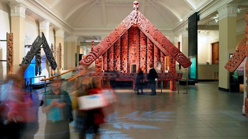 Full-size intricately carved Maori building at the Auckland Museum in Auckland