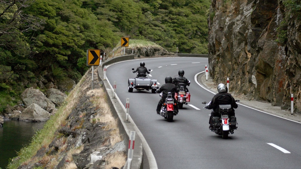 Harley riders on a mountain-side road in Auckland
