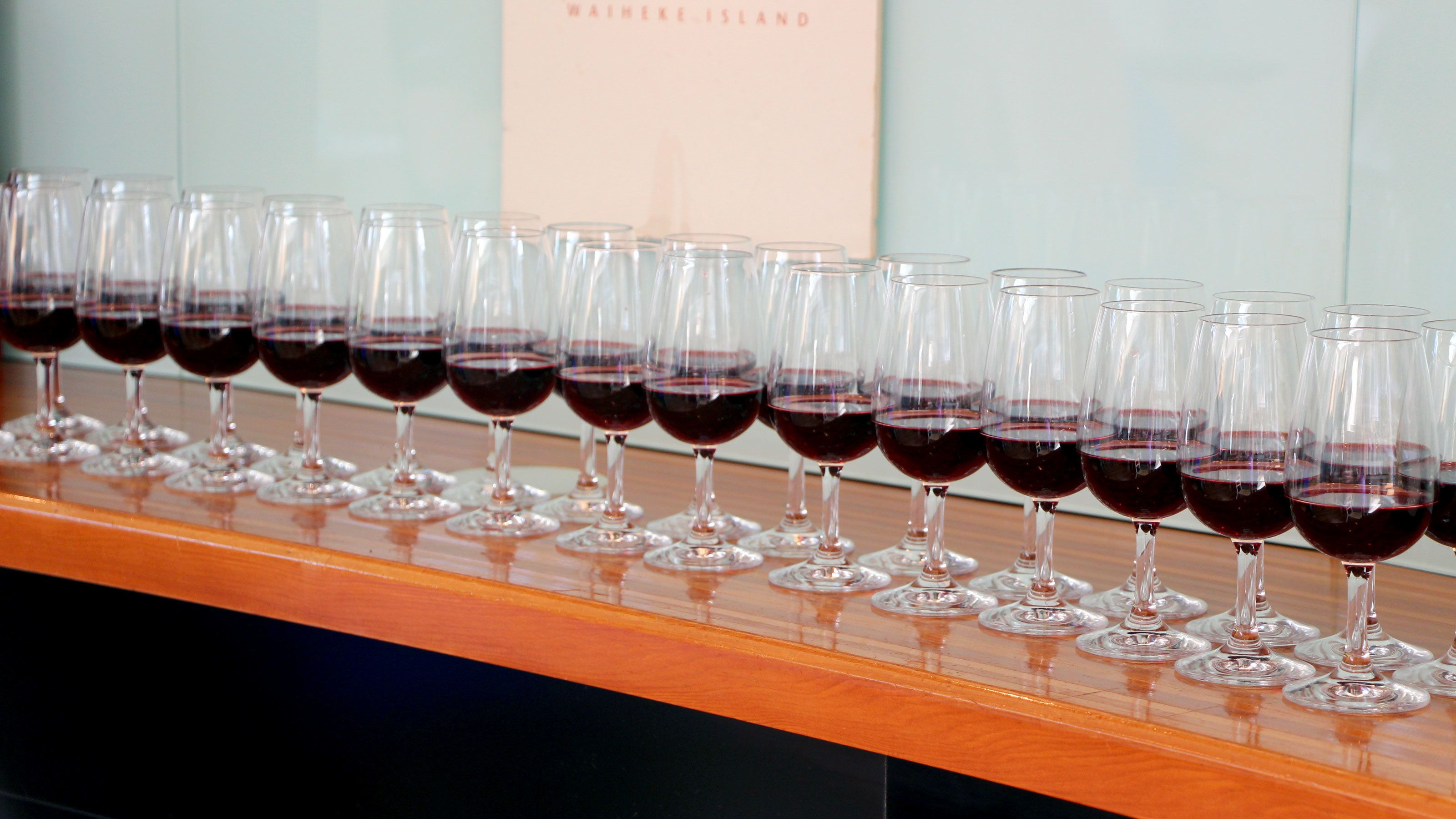 Row of wine glasses with red wine at a vineyard on Waiheka Island