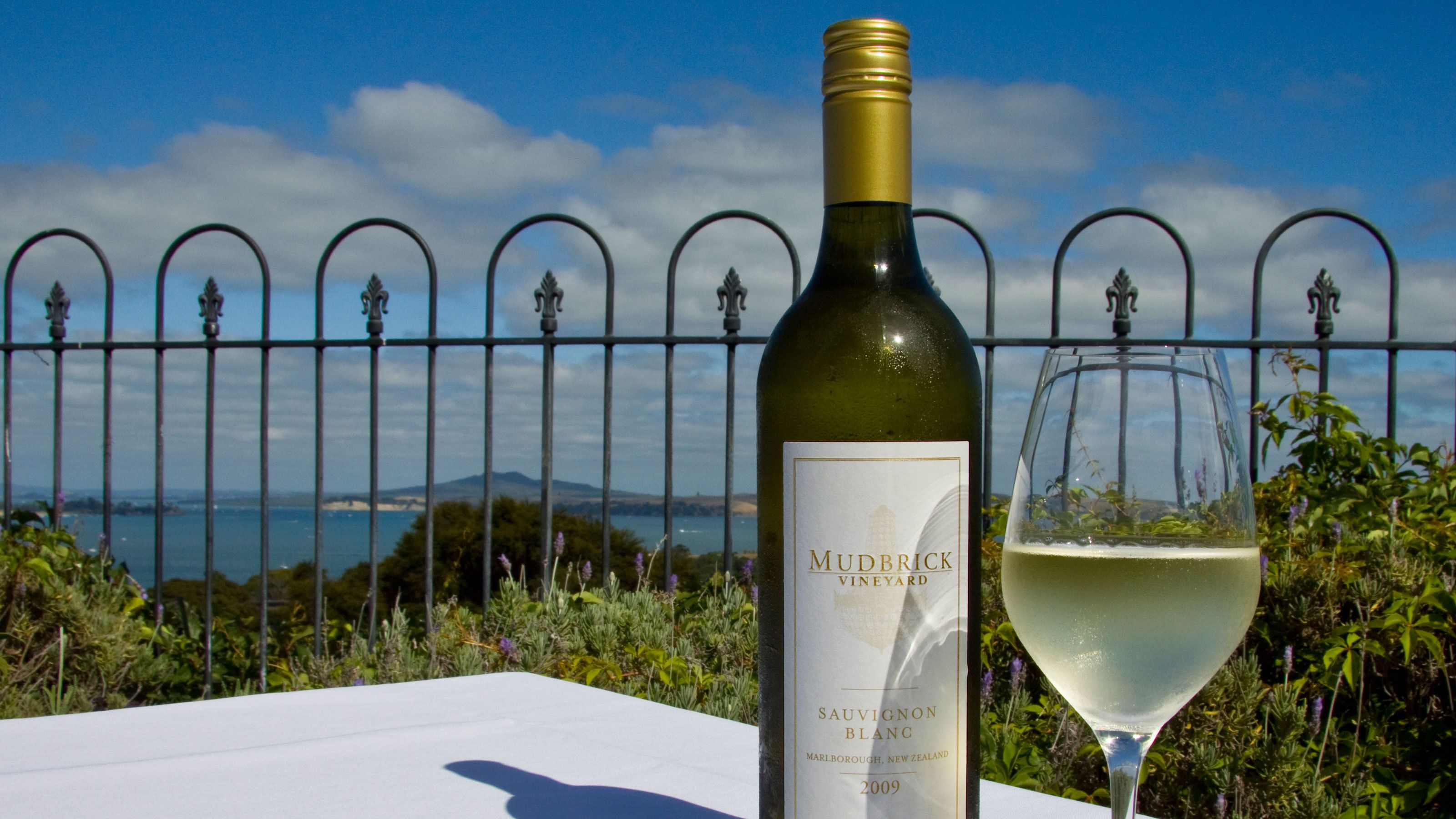 Bottle and glass of white wine at a vineyard on Waiheka Island