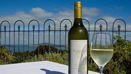 Bottle and glass of white wine at a vineyard on Waiheka Island