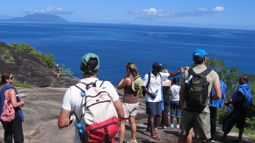 Tour group enjoying their visit at Mahé Island in Seychelles