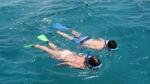 Two people snorkeling in the waters in Seychelles