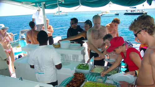 catamaran passengers serving themselves lunch in Mauritius