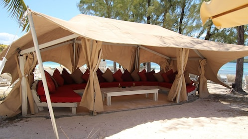 big lounge tent pitched at the beach in Ile des Deux Cocos