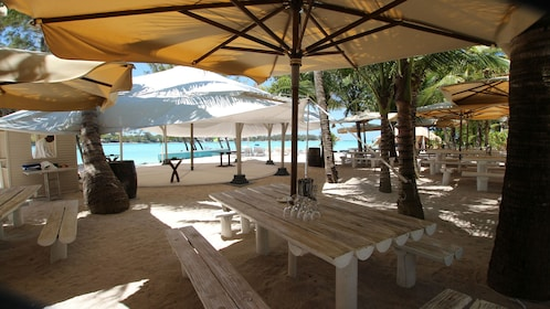 shaded dining and lounge experience at the beahc in Ile des Deux Cocos
