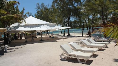 beach chairs set up near the lounge establishment in Ile des Deux Cocos
