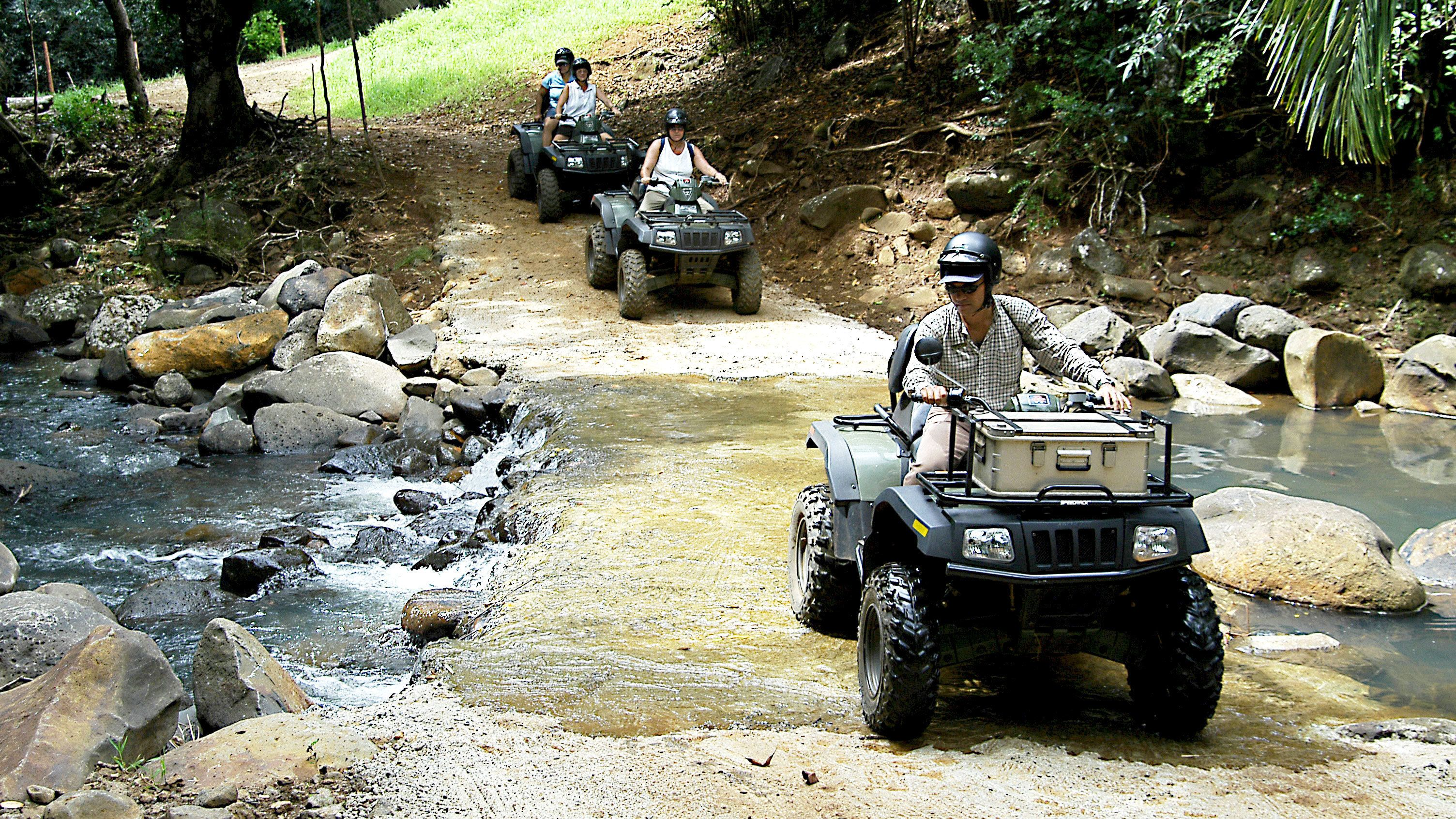 quad bikers crossing a shallow creek at the Frederica Nature Reserve