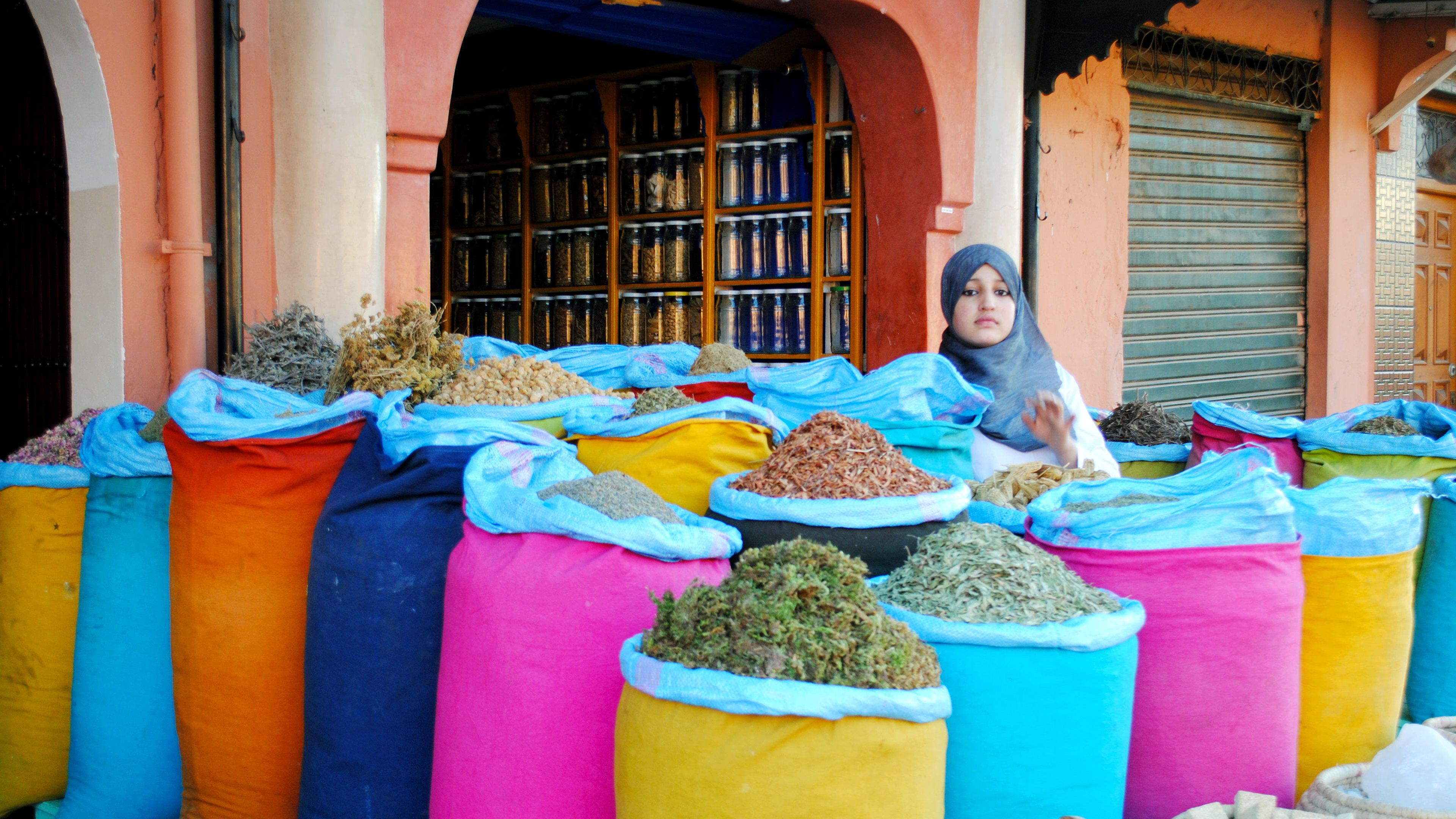 Colorful bags of herbs and spices for sale at a market in Marrakech