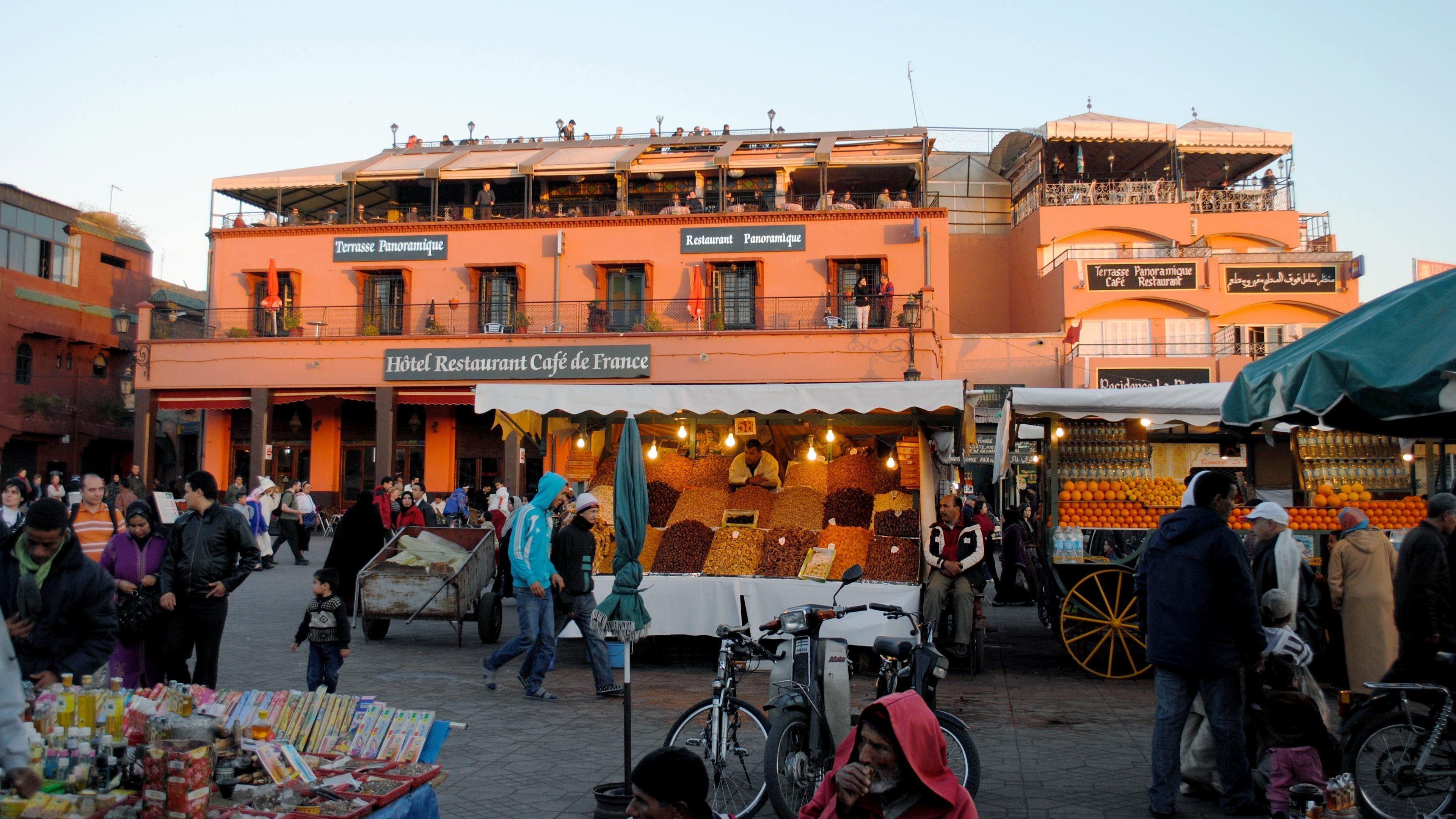 Market stalls and nearby restaurants in Marrakech