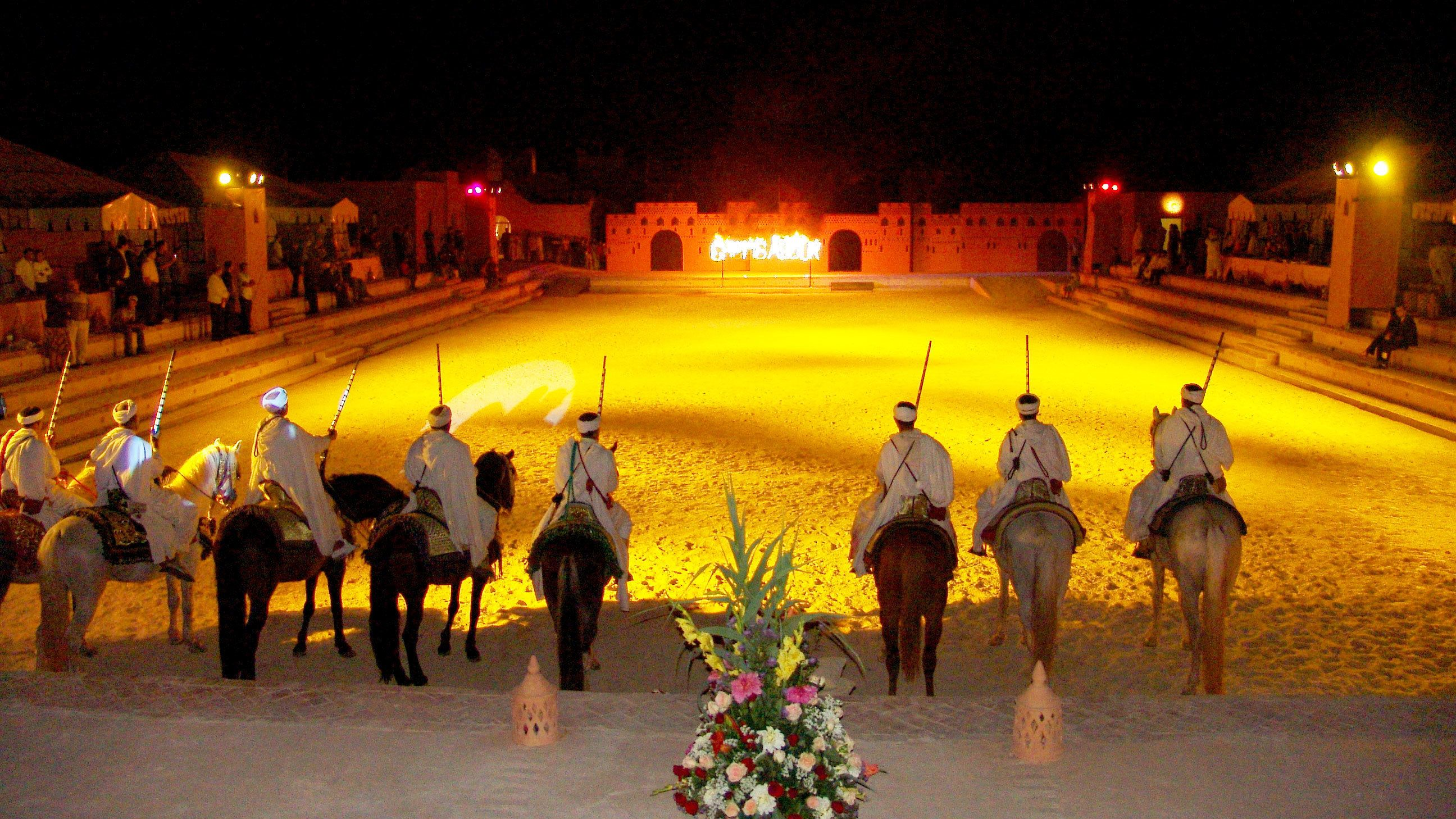 Stallion riding performers during a performance in Agadir