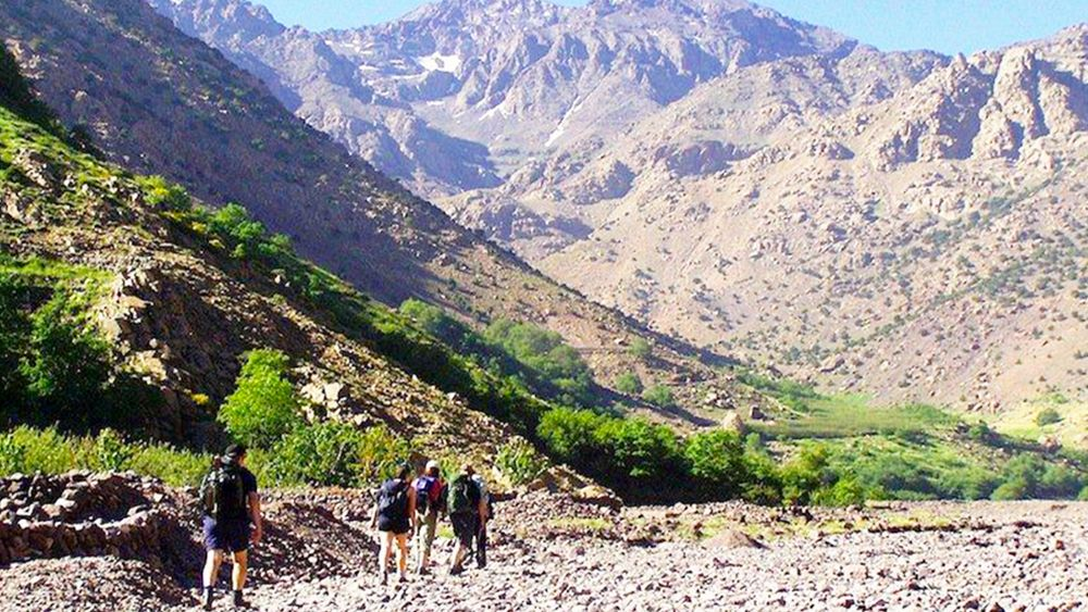 Hiking group at the base of the Atlas Mountains in Morocco