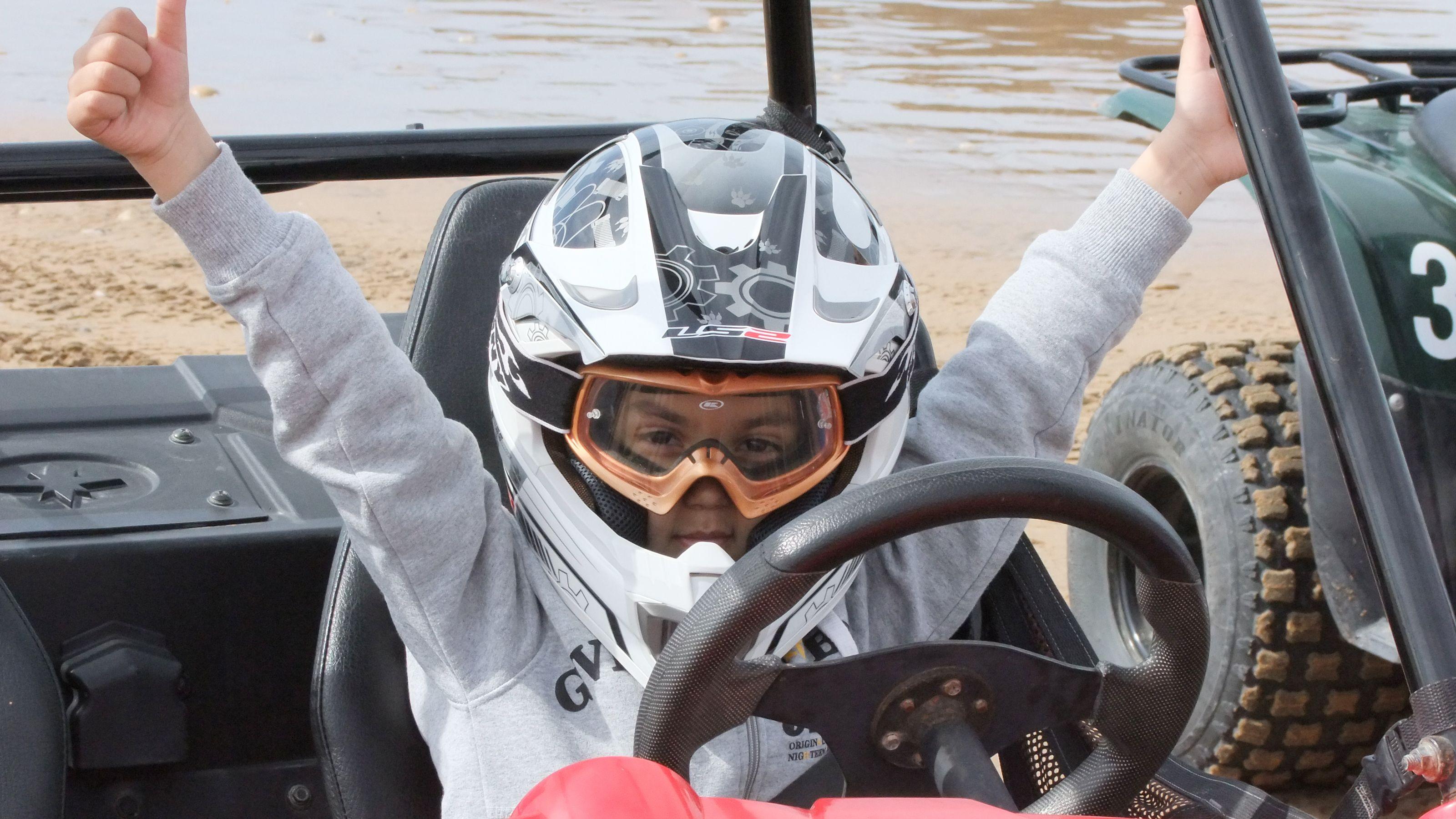 Dune buggy driving kid behind the wheel in Agadir