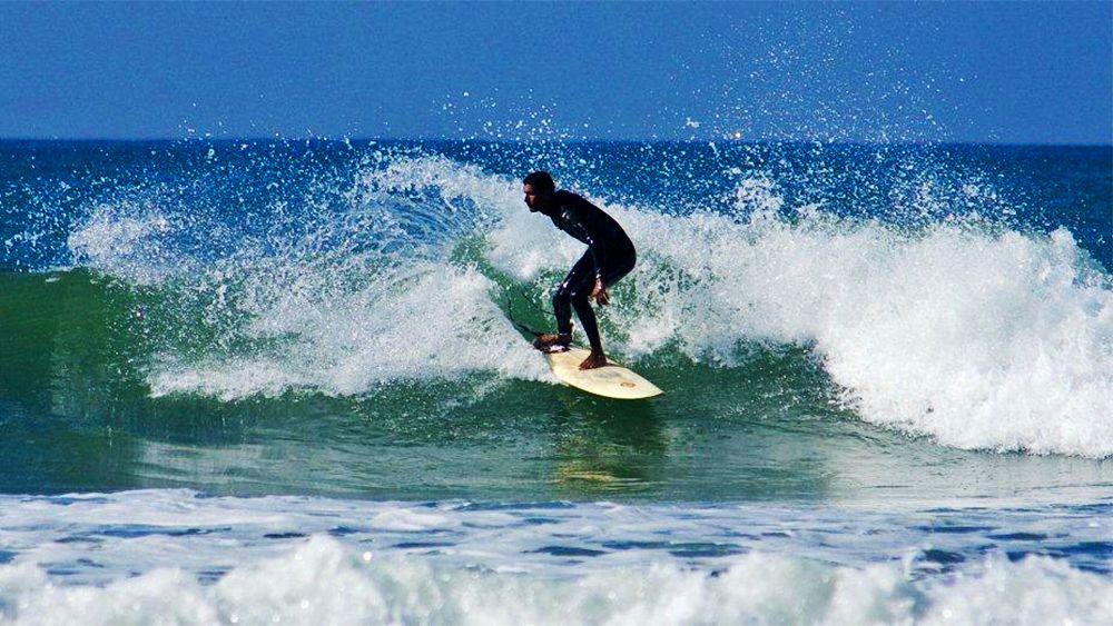 Surfing man in the water in Agadir