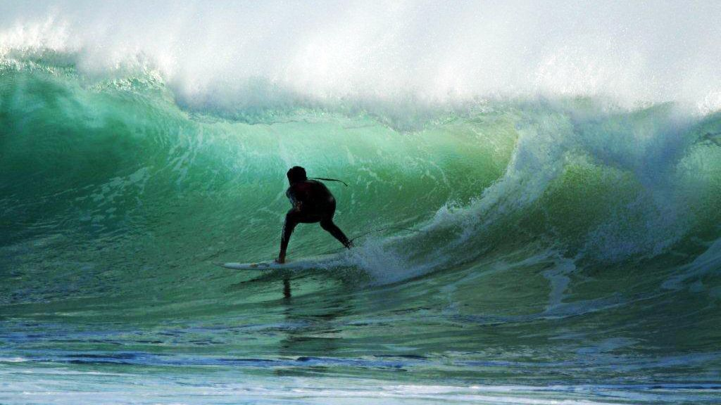 Surfer in the curl of a wave in Agadir