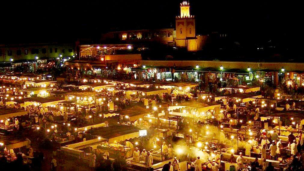 Marrakech market lit up at night