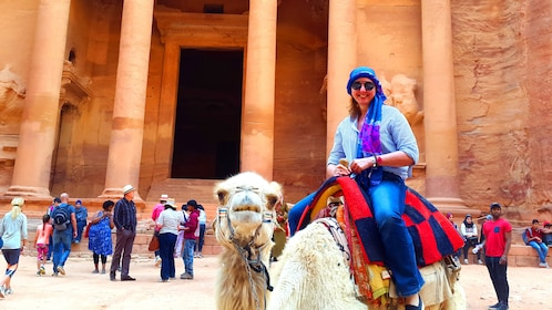 People on Camelback in Al Khazneh temple in Petra City