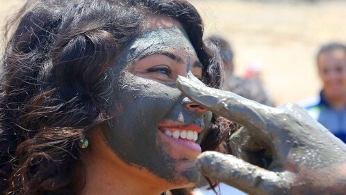 Woman gets a mud mask
