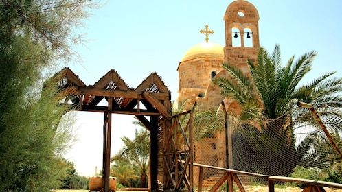small wooden shed outside of a church in Jordan