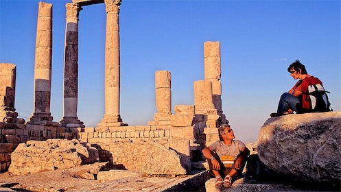 Couple resting near the Temple of Hercules in Amman