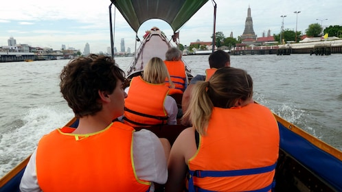 people on a boat in bangkok
