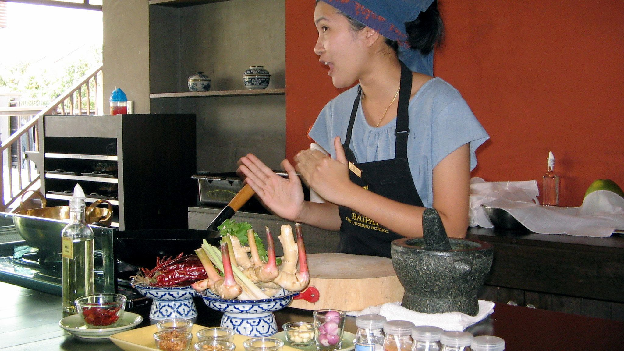 A cooking instructor teaching a class in Bangkok