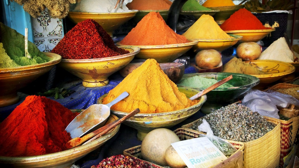 Show item 3 of 5. colorful spices at the street market in Tangier