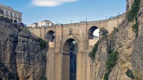 crossing the Puente Nuevo Bridge in the city of Ronda