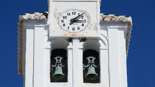 white clock and bell tower in Frigiliana