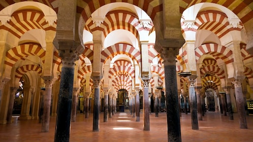 striped archways inside the Cathedral of Cordoba in Spain