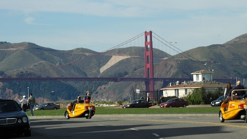 GoCAR rentals with the Golden Gate Bridge and hills in the distance