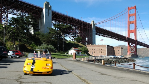 GoCAR rental with man and child near the Golden Gate Bridge in San Francisco