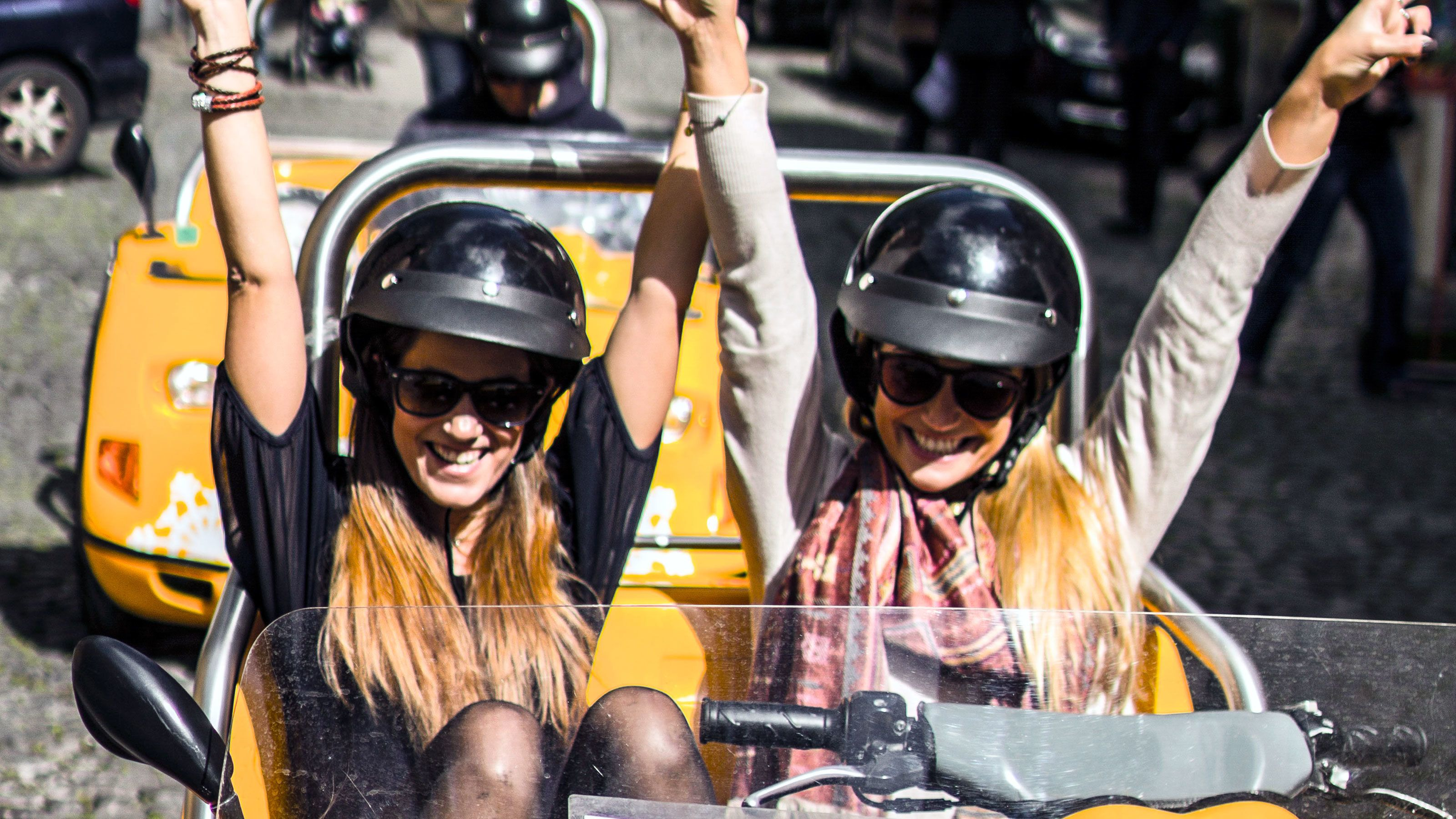 women in Go Car ready to explore the city of Lisbon