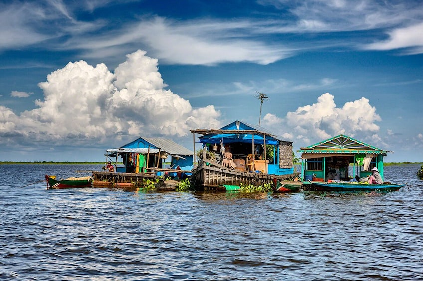 A girl floats with her make-shift boat on Tonle Sap Lake
