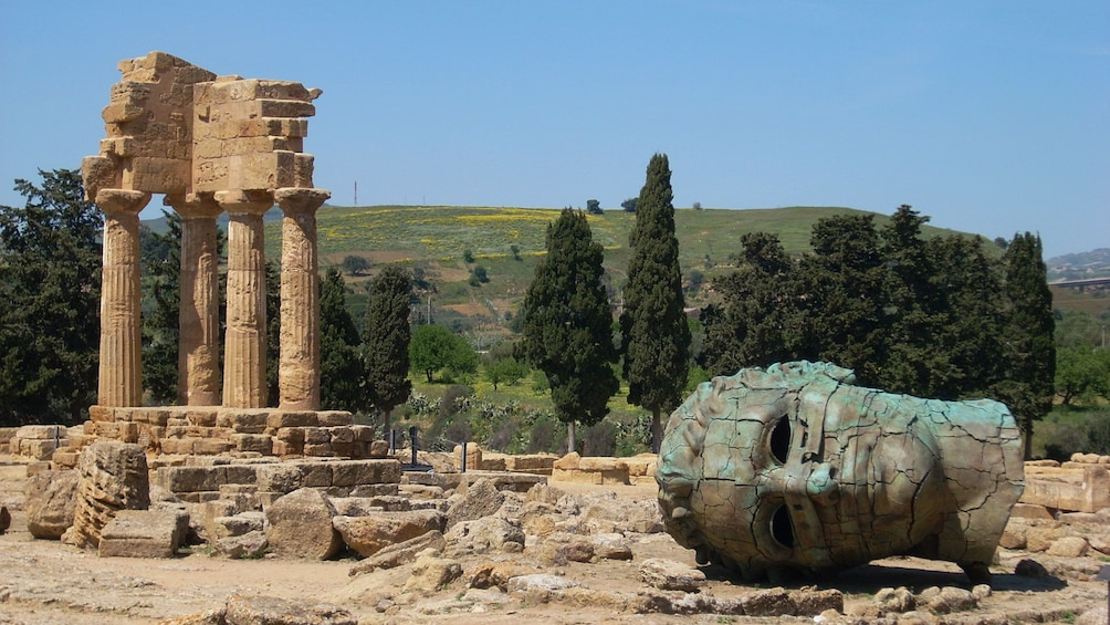 head of a statue among the temple ruins in Sicily