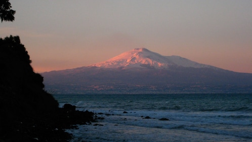 snow capped Mount Etna in Sicily