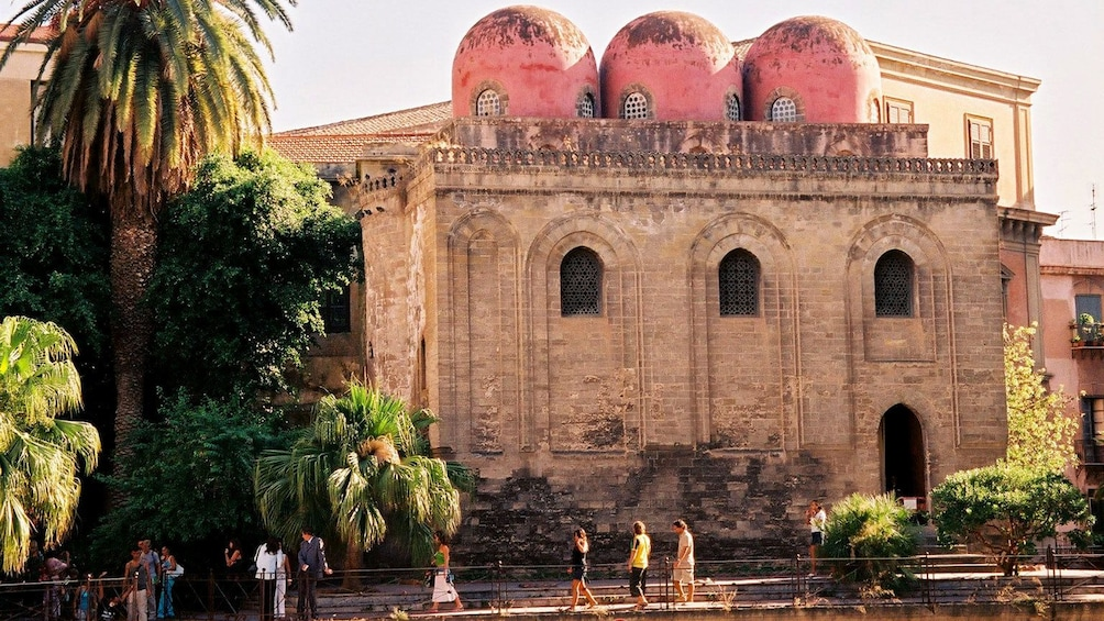 old building with red domed towers in Sicily