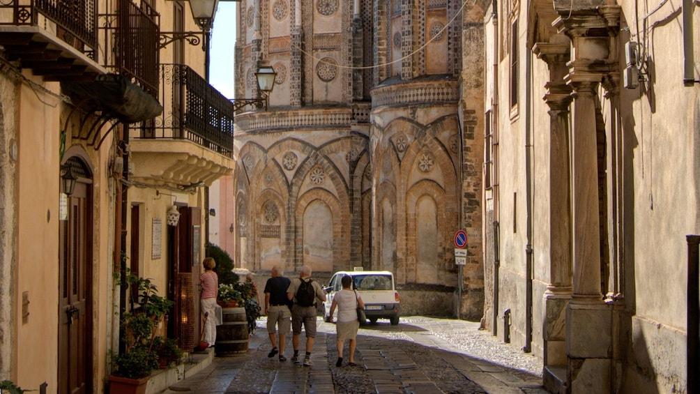 walking on narrow stone roads in Sicily