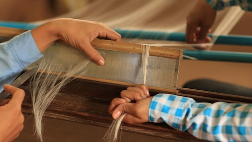 Close view of the silk production process in Siem Reap